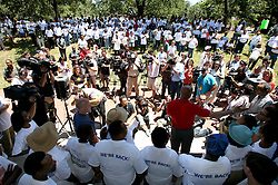 May 20th, 2006. New Orleans, Louisiana. The IAF Network of Katrina Survivors organised a rally outside city hall for displaced voters who were bussed in from Houston and other cities to vote. (left, in blue) Mayoral challenger Louisiana Lieutenant Governor Mitch Landrieu and Mayor Ray Nagin (rt in red) share the stage.<br /> Photo; Charlie Varley/varleypix.com