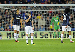 Man Utd Midfielder Tom Cleverley (ENG) and his team mates cut dejected figures - Photo mandatory by-line: Joseph Meredith/JMP - Tel: Mobile: 07966 386802 - 24/11/2013 - SPORT - FOOTBALL - Cardiff City Stadium - Cardiff City v Manchester United - Barclays Premier League.