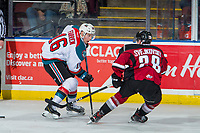 KELOWNA, CANADA - JANUARY 26:  Michael Farren #16 of the Kelowna Rockets i9s checked by Lukas Svejkovsky #28 of the Vancouver Giants on January 26, 2019 at Prospera Place in Kelowna, British Columbia, Canada.  (Photo by Marissa Baecker/Shoot the Breeze)