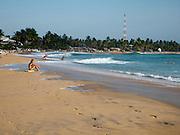Sri Lanka, Ampara District, Arugam Bay, Pottuvil a small fishing village and popular surfing resort. Tourists on the beach