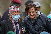 London, UK, May 8, 2021 — Former veterans minister Johnny Mercer speaks and takes pictures with people after a 'Respect our Veterans' march in Parliament Square, central London on Saturday, May 8, 2021. The march follows the collapse of the controversial trial earlier this week against two paratroopers accused of murdering Official IRA leader Joe McCann in 1972. (Photo/ Vudi Xhymshiti)