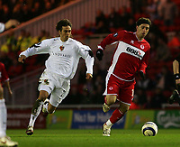 Photo: Jed Wee.<br /> Middlesbrough v FC Basle. UEFA Cup. Quarter-Final. 06/04/2006.<br /> <br /> Middlesbrough's Fabio Rochemback (R) gets past Basel's Matias Emilio Delgado.