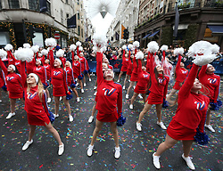 Members of the Varsity All American Cheerleaders perform during the London New Year's Day Parade.