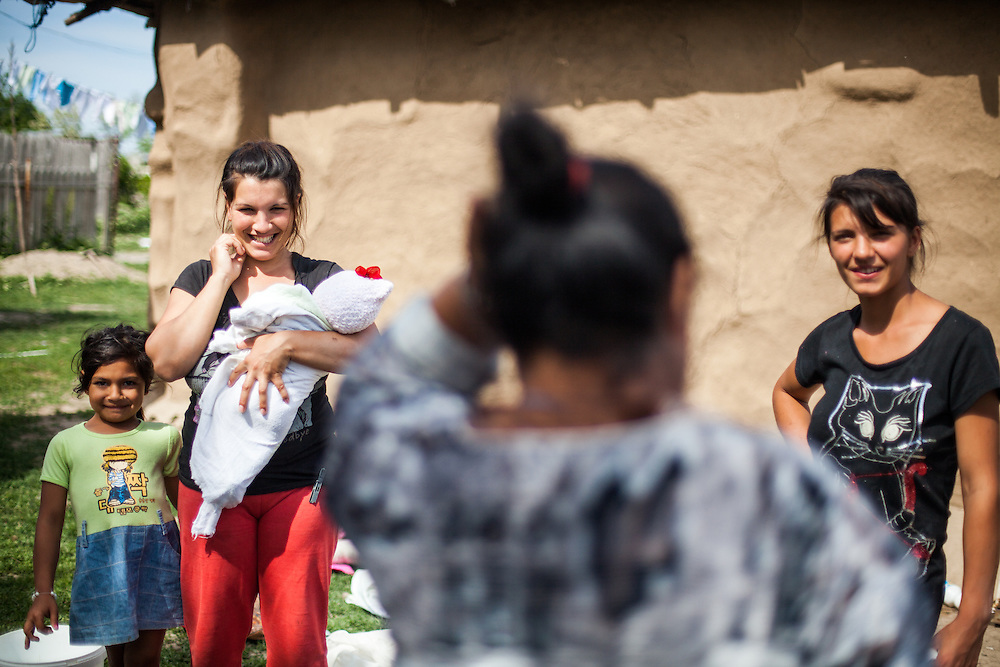 Two young mothers at the Roma area of Frumusani. Constantin Ionela (right) is 14 years old and has a 6 months old child.
