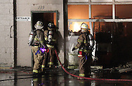 Middletown, New York - Firefighters work at the scene of a fire at The Engine Shop on North Street in Middletown late on the night of Friday, April 20, 2012.
