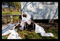 8th Sept, 2005. Hurricane Katrina aftermath. New Orleans. An old lady rots in her wheelchair, dumped behind a dentist office in East New Orleans. Her body has been there for 10 days.