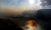 Aerial view shows the south side of Lake Chelan across the water from the town of Manson. On the bottom center, an Erickson Air-Crane helicopter returns to the fire with approximately 2,400 gallons of water. Friday August 21, 2015<br /> <br /> Alan Berner / The Seattle Times