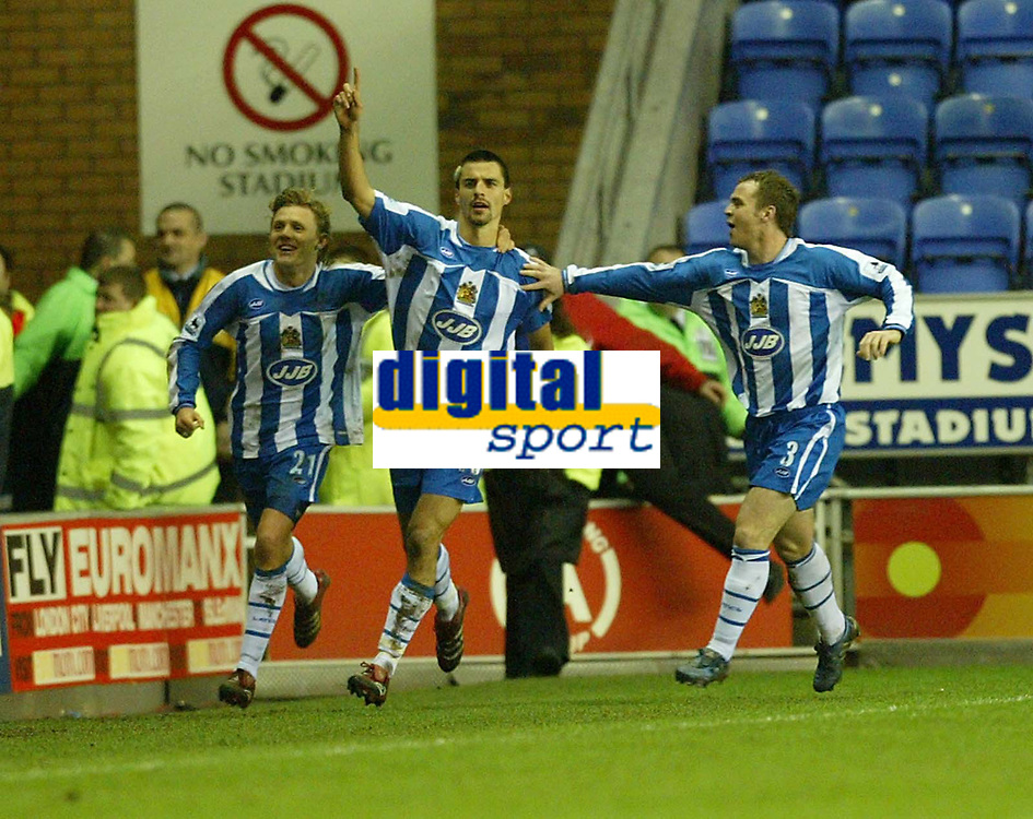 Photo: Aidan Ellis.<br /> Wigan Athletic v Arsenal. Carling Cup. Semi Final, 1st Leg.<br /> 10/01/2006.<br /> Wigan's Paul Scharner celebrates his goal with Jimmy Bullard and Andreas Johansson