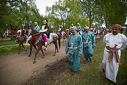 © London News Pictures. 12/05/2012. Windsor, UK. The Royal Cavalry of Oman prepare for the Diamond Jubilee Pageant on the banks of the River Thames in the grounds of Windsor Castle in windsor, Berkshire on May 12, 2012. 1200 performers and 600 horses from countries all around the world take part in the Pageant which runs for four nights celebrating 60 years on the throne for Queen Elizabeth II.. Photo credit: Ben Cawthra/LNP