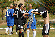 The undefeated Deportivo Colomex (Black) greet members of Team Shlama F.C. (Blue) after Colomex continued their undefeated season with a 3-1 victory during National Soccer League play in Skokie, Il.