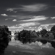 St. James's Park is a 23 hectare  park in Westminster, the oldest of the Royal Parks of London, is bounded by Buckingham Palace to the west. The park has a small lake, St. James's Park Lake, with two islands, Duck Island (named for the lake's collection of waterfowl), and West Island. A bridge across the lake affords a view of Buckingham Palace framed by trees and fountains, and a view of the main building of the Foreign and Commonwealth Office, similarly framed, to the east. London Eye can be seen in background