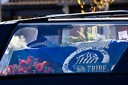 © Licensed to London News Pictures. 04/11/2020. Shoreham, UK. Police Sgt Matt Ratana's cap rests on his coffin as the funeral cortege leaves a funeral directors in Shoreham, West Sussex after a service was held. Family members were joined by police colleagues including Metropolitan Police Commissioner Cressida Dick. A traditonal Maori Haka was performed during the service. Sgt Ratana died from a gunshot wound to the chest in the early hours of September 25 at Croydon custody centre. Photo credit: Peter Macdiarmid/LNP