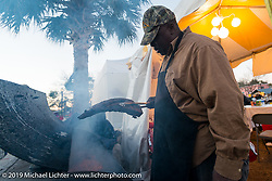 The best BBQ in town can always be had at the Biking on the Boulevard event during Daytona Bike Week. FL, USA. March 13, 2014.  Photography ©2014 Michael Lichter.
