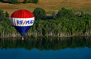 SHOT 7/18/17 6:27:46 AM - Launching the new RE/MAX balloon around Hatfield State Park in Littleton, Co. The RE/MAX balloon is one of the most recognized corporate symbols on the planet and was first introduced at the Albuquerque Balloon Fiesta in 1978. Today, the nearly 120 RE/MAX Hot Air Balloons in operation comprise the largest fleet in the world.  (Photo by Marc Piscotty / © 2017)