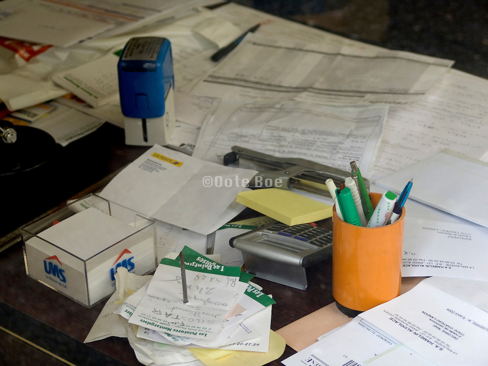 still life of a messy office table with paperwork