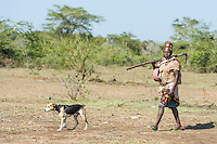 Mozambican lady walking to her croplands with her dog, Limpopo floodplain, Maputo Province, Mozambique