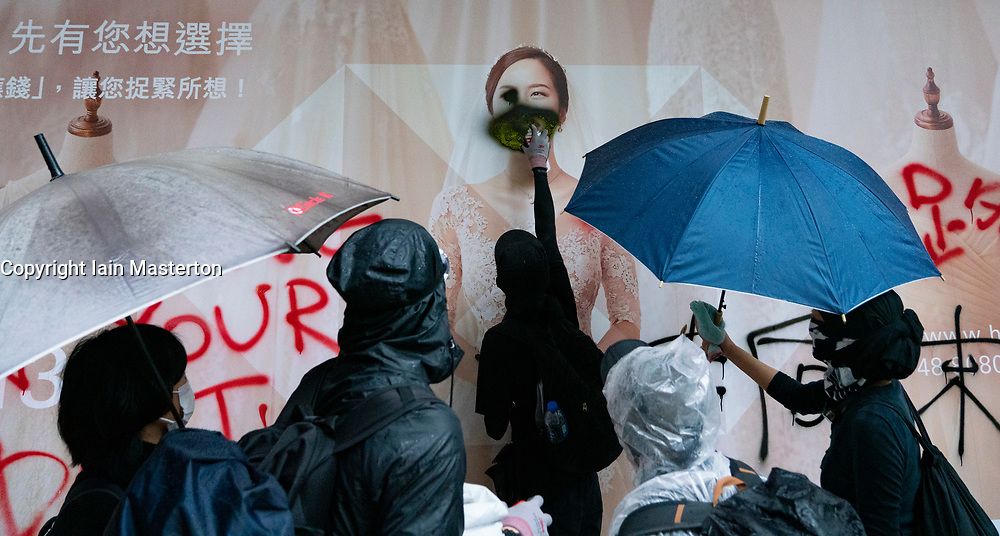 Hong Kong. 6 October 2019. Tens of thousands of pro-democracy protestors march in pouring rain through centre of Hong Kong today from Causeway Bay to Central. Peaceful march later turned violent as a hard-core of protestors confronted police. Pic; HSBC bank branch shopfront is vandalised.  Iain Masterton/Alamy Live News.