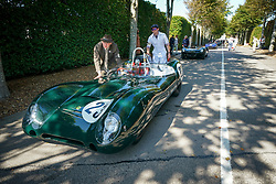© Licensed to London News Pictures. <br /> 13/09/2019. <br /> Goodwood.West, Sussex. UK.<br /> The Goodwood Motor Circuit celebrates the 21st year of the Revival.This has become one of the biggest annual historic motorsport events in the world and the only one to be staged entirely in period dress. Each year over 150,000 people descend on this quiet corner of West Sussex to enjoy the three-day event.<br /> Pictured a classic Lotus is pushed to the paddock.<br /> Photo credit: Ian Whittaker/LNP