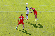 Queens Park Rangers midfielder Olamide Shodipo (17) and Barnsley defender Michael Sollbauer (18) clash in the air during the EFL Sky Bet Championship match between Queens Park Rangers and Barnsley at the Kiyan Prince Foundation Stadium, London, England on 20 June 2020.