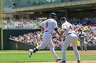 Ryan Doumit #9 of the Minnesota Twins is congratulated by 3rd base coach Joe Vavra #46 after hitting a home run against the Seattle Mariners on June 2, 2013 at Target Field in Minneapolis, Minnesota.  The Twins defeated the Mariners 10 to 0.  Photo: Ben Krause
