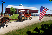 Jeff Wunrow passes an American flag as he heads in for another load of seed at his farm near Potter, Wisconsin,