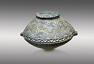 Early Minoan round bronze box with intricate pattern on lid,  George of the Dead 2600-2300 BC BC, Heraklion Archaeological  Museum,  , grey background. .<br /> <br /> If you prefer to buy from our ALAMY PHOTO LIBRARY  Collection visit : https://www.alamy.com/portfolio/paul-williams-funkystock/minoan-art-artefacts.html . Type -   Heraklion   - into the LOWER SEARCH WITHIN GALLERY box. Refine search by adding background colour, place, museum etc<br /> <br /> Visit our MINOAN ART PHOTO COLLECTIONS for more photos to download  as wall art prints https://funkystock.photoshelter.com/gallery-collection/Ancient-Minoans-Art-Artefacts-Antiquities-Historic-Places-Pictures-Images-of/C0000ricT2SU_M9w