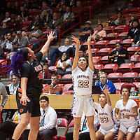 Kirtland Central Bronco Tatelyn Manheimer (22) as Gallup Bengal Hailey Long (40) defends during their 4A girls NMAA State Basketball quarterfinal playoff game at Dreamstyle Arena (The Pit) Tuesday night in Albuquerque. The Broncos beat the Bengals 61-54 to advance to the semifinal round.