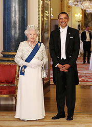 File photo dated 24/05/11 of Queen Elizabeth II and the then US President Barack Obama in the Music Room of Buckingham Palace, London.