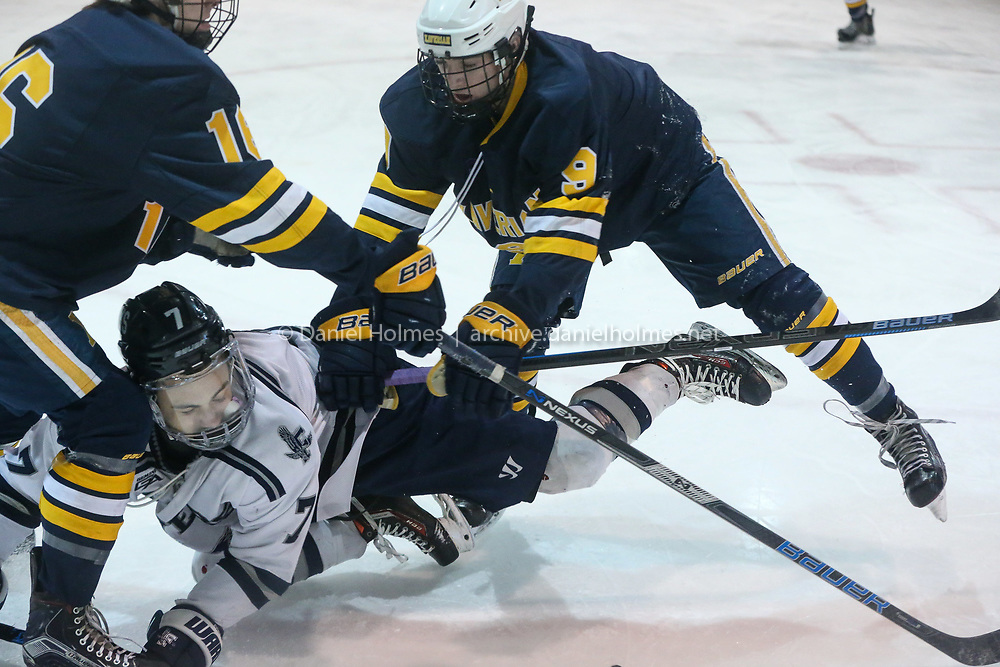(2/16/19, FRAMINGHAM, MA) Framingham's Robbie Lopez  takes a hit during the boys hockey game against Xaverian at Loring Arena in Framingham on Saturday. [Daily News and Wicked Local Photo/Dan Holmes]