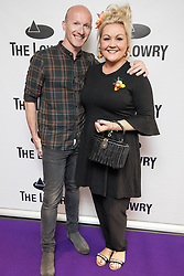 © Licensed to London News Pictures . 30/08/2017 . Salford , UK . Adam Blease and Lisa George . Purple carpet photos of celebrities, actors and invited guests arriving for the press night of the musical comedy , Addams Family , at the Lowry Theatre . Photo credit : Joel Goodman/LNP