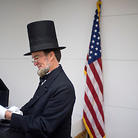 010815       Cable Hoover<br /> <br /> Actor and historian John Voehl pulls on the final pieces of his costume as he prepares for a presentation about Abraham Lincoln at the Octavia Fellin Public Library in Gallup Thursday.