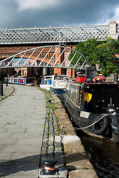 Manchester Bridgewater Canal and the foot bridge that links Slate wharf with Castle Street with Manchester Metro Link in the Background..29  September 2012.Image © Paul David Drabble