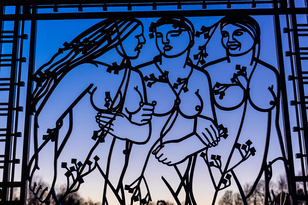 An iron gate with nude female figures at the sculpture park of Gustav Vigeland in the Frogner Park in Oslo, Norway. It is a permanent sculpture installation created by Gustav Vigeland between 1924 and 1943. It is the world's largest sculpture park made by a single artist, and is one of Norway's most popular tourist attractions. In the center is a monolith.