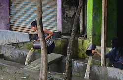 May 25, 2019 - Dimapur, Nagaland, India - Residents scoop rain water after a heavy shower in Dimapur, India north eastern state of Nagaland. (Credit Image: © Caisii Mao/NurPhoto via ZUMA Press)