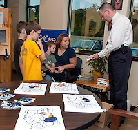 (Karen Bobotas/for the Laconia Daily Sun)Gilford Police Department and Children's Dentistry of the Lakes Region host Child ID booklet program September 15, 2011.  (Karen Bobotas/for the Laconia Daily Sun)