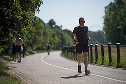 © Licensed to London News Pictures. 13/06/2021. London, UK. A man Jogging in the early morning warm weather in Hyde Park central London on a hot summer's day. Temperatures in the capital are expected to reach a high for the year. Photo credit: Ben Cawthra/LNP