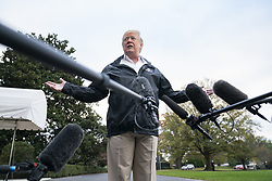 U.S. President Donald J. Trump speaks to the media before he departs the White House for California, where he is scheduled to view damage from that state's wildfires, in Washington, DC, USA, 17 November 2018. Seventy-four people have been killed and more than 1,000 people are missing due to multiple devastating fires across the state. The President spoke about the investigation into Jamal Khashoggi's murder, the Mueller investigation, and the migrant caravan approaching the southern border.