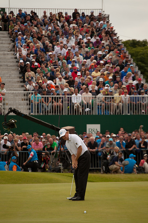 LYTHAM ST. ANNES, ENGLAND - JULY 22:  Ernie Els plays  makes a birdie putt at the 18th hole during the final round of the 141st Open Championship at Royal Lytham St Annes Golf Club in in Lytham St. Annes, England on July 22, 2012. (Photograph ©2012 Darren Carroll) *** Local Caption *** Ernie Els