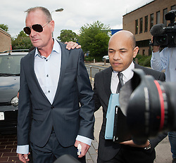 © London News Pictures. 05/08/2013. Stevenage, UK. Former England footballer PAUL GASCOIGNE (AKA Gazza, left) arriving at Stevenage Magistrates Court in Hertfordshire. Gascoigne, 46, was charged last month with two counts of common assault following an incident at Stevenage railway station on July 4. Photo credit: Ben Cawthra/LNP