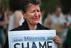 June 18, 2017 - St. Anthony, Minnesota, U.S. - Unitarian minister Rev. LAURIE BUSHBAUM carries a sign that shows how she feels about the Jeronimo Yanez verdict during a Father's Day memorial rally in honor of Philando Castile. (Credit Image: © Richard Tsong-Taatarii/TNS via ZUMA Wire)