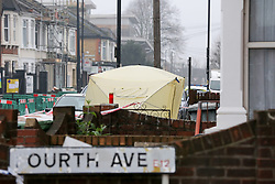 © Licensed to London News Pictures. 09/04/2019. London, UK. A police tent on Church Road, Manor Park, East London where a man in his 20s was shot and stabbed to death on Monday 8 April 2019. Police were called around 9.30pm and the man was found with knife and gunshot wounds. The victim was pronounced dead at the scene. Photo credit: Dinendra Haria/LNP