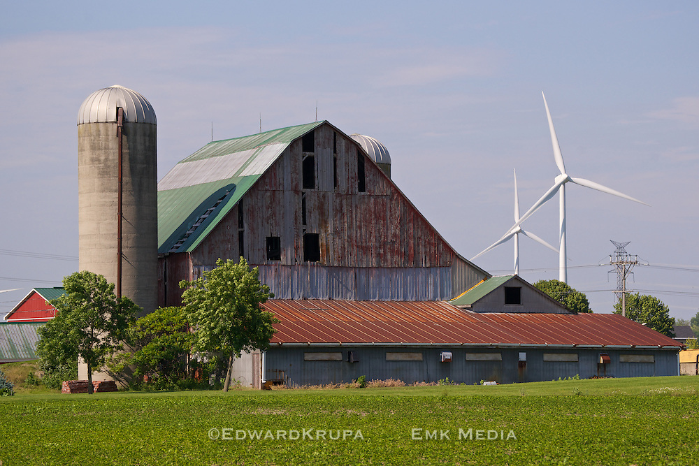 Farm in Bruce County Ontario, with barn wind turbines and transmission lines.