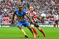 Omar Beckles of Shrewsbury Town (6) and Danny Rowe of Lincoln City (24) battle for the ball during the EFL Trophy Final match between Lincoln City and Shrewsbury Town at Wembley Stadium, London, England on 8 April 2018. Picture by Stephen Wright.