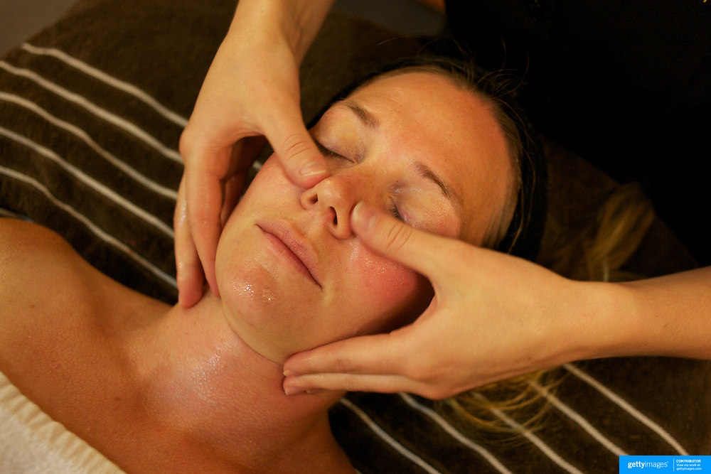 A young women receiving facial beauty treatment in a beauty spa. Photo Tim Clayton.