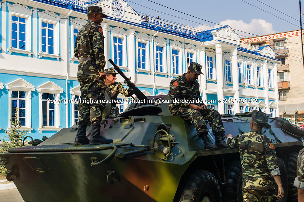 20150831 Moldova, Transnistria,Pridnestrovian Moldavian Republic (PMR) Tiraspol. Rehersal for the big parade, in the 25th  Transnistrian independance day when  they had a war separating from Moldova.Military on a tank in front of the new blue hospital in the main street, 25th October street.