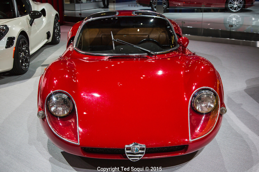 A 1968 33 Stradale from Alfa Romeo. It is considered one of the most beautiful cars ever made. Most collectors believe this car to be worth up to $10 million dollars if one was for sale. It has a 2.0 litre V8 motor that makes 230hp. It was designed by Franco Scaglione and made in Italy. <br /> The 2015 Los Angeles Auto Show at the LA Convention Center.