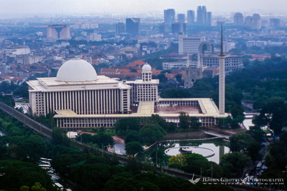 Indonesia, Java, Jakarta. View from MONAS, a lift runs to te top of the monument. Istiqlal mosque was constructed under Sukarno, and said to be the largest mosque in South-East Asia.