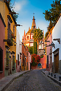 "Picturesque scene in the historic center of San Miguel de Allende, exico<br /> ------<br /> San Miguel de Allende is a city and municipality located in the far eastern part of the state of Guanajuato in central Mexico. It is part of the macroregion of Bajío. Historically, the town is important as being the birthplace of Ignacio Allende, whose surname was added to the town's name in 1826, as well as the first municipality declared independent of Spanish rule by the nascent insurgent army during the Mexican War of Independence. However, the town waned during and after the war, and at the beginning of the 20th century was in danger of becoming a ghost town. Its Baroque/Neoclassical colonial structures were ""discovered"" by foreign artists who moved in and began art and cultural institutes such as the Instituto Allende and the Escuela de Bellas Artes. This gave the <br /> This attracted foreign art students, especially former U.S. soldiers studying on the G.I. Bill after the Second World War. Since then, the town has attracted a significant amount of foreign retirees, artists, writers and tourists, which is shifting the area's economy from agriculture and industry to commerce catering to outside visitors and residents. The main attraction of the town is its well-preserved historic center, filled with buildings from the 17th and 18th centuries. This and the nearby Sanctuary of Atotonilco have been declared World Heritage Sites in 2008."