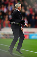 Mark Hughes, the manager of Stoke city celebrates after his side score and go 1-0 up. Premier league match, Stoke City v Arsenal at the Bet365 Stadium in Stoke on Trent, Staffs on Saturday 19th August 2017.<br /> pic by Bradley Collyer, Andrew Orchard sports photography.