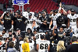 UCF Knights celebrate after the second half of the Chick-fil-A Peach Bowl NCAA college football game at the Mercedes-Benz Stadium in Atlanta, January 1, 2018. UCF won 34-27 to go undefeated for the season. (David Tulis via Abell Images for Chick-fil-A Peach Bowl)